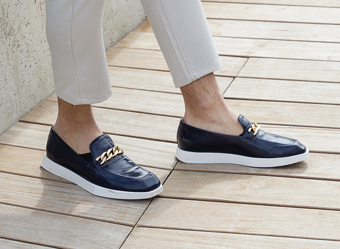 Loafers with metal accessory